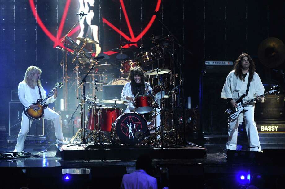 Dave Grohl and Taylor Hawkins of Foo Fighters and producer Nick Raskulinecz perform onstage at the 28th Annual Rock and Roll Hall of Fame Induction Ceremony at Nokia Theatre L.A. Live on April 18, 2013 in Los Angeles. Photo: Kevin Winter, Getty Images / 2013 Getty Images