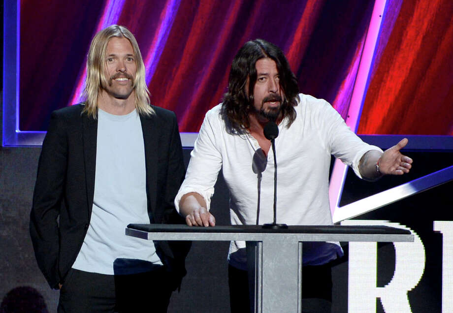 Taylor Hawkins (L) and Dave Grohl speak on stage at the 28th Annual Rock and Roll Hall of Fame Induction Ceremony at Nokia Theatre L.A. Live on April 18, 2013 in Los Angeles. Photo: Kevin Winter, Getty Images / 2013 Getty Images