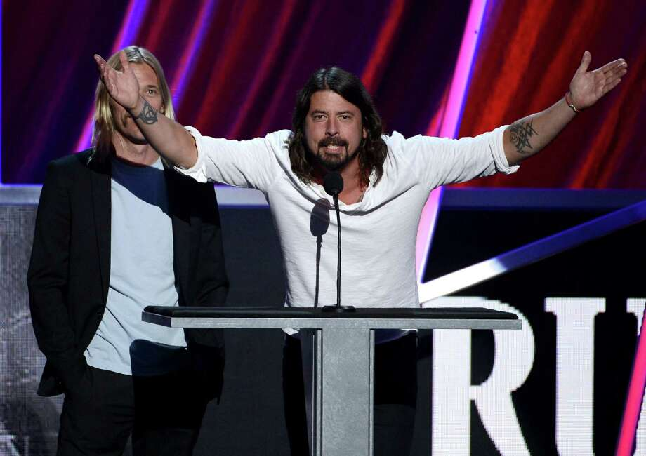 Taylor Hawkins and Dave Grohl of Foo Fighters speak  on stage at the 28th Annual Rock and Roll Hall of Fame Induction Ceremony at Nokia Theatre L.A. Live on April 18, 2013 in Los Angeles. Photo: Kevin Winter, Getty Images / 2013 Getty Images