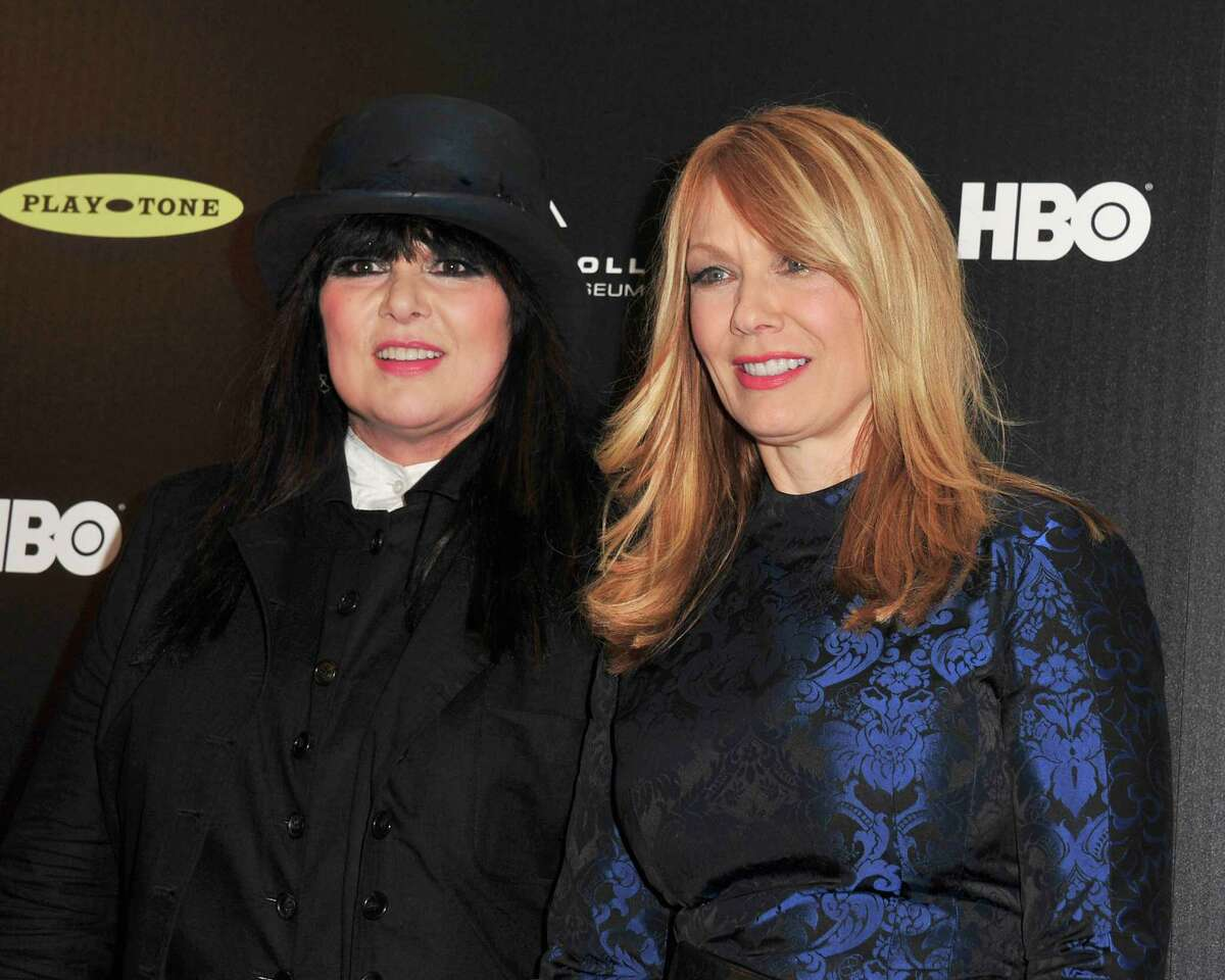 Ann Wilson (L) and Nancy Wilson of Heart pose in the press room at the 28th Annual Rock and Roll Hall of Fame Induction Ceremony at Nokia Theatre L.A. Live at Nokia Theatre L.A. Live on April 18, 2013 in Los Angeles. (Photo by Mark Sullivan/FilmMagic)