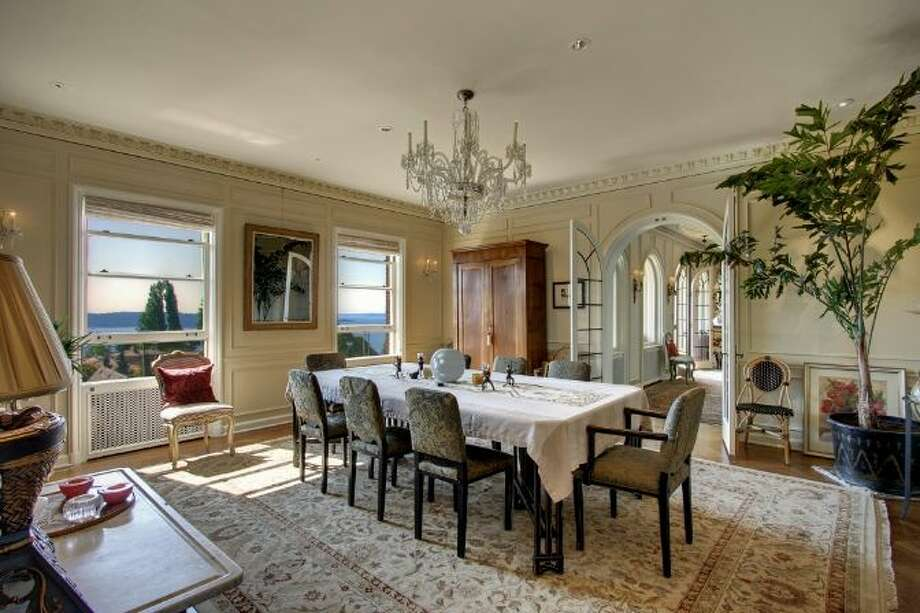 Dining room of 619 W. Comstock St., in Queen Anne, which is listed for sale for $6.8 million. The 10,600-square-foot mansion, built in 1926, has seven bedrooms, five bathrooms, a second kitchen, a wine cellar, arched doorways, French doors, high ceilings, massive moldings, a grand balcony, a koi pond and views of downtown Seattle, Mount Rainier, Elliott Bay and Puget Sound on a 0.42-acre lot. It's listed for $6.8 million. Photo: Courtesy Ann Dover, Windermere Real Estate