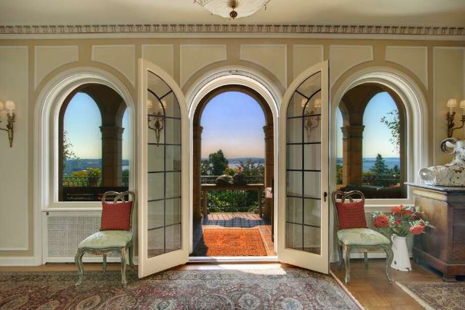 Hallway of 619 W. Comstock St., in Queen Anne, which is listed for sale for $6.8 million. The 10,600-square-foot mansion, built in 1926, has seven bedrooms, five bathrooms, a second kitchen, a wine cellar, arched doorways, French doors, high ceilings, massive moldings, a grand balcony, a koi pond and views of downtown Seattle, Mount Rainier, Elliott Bay and Puget Sound on a 0.42-acre lot. It's listed for $6.8 million. Photo: Courtesy Ann Dover, Windermere Real Estate