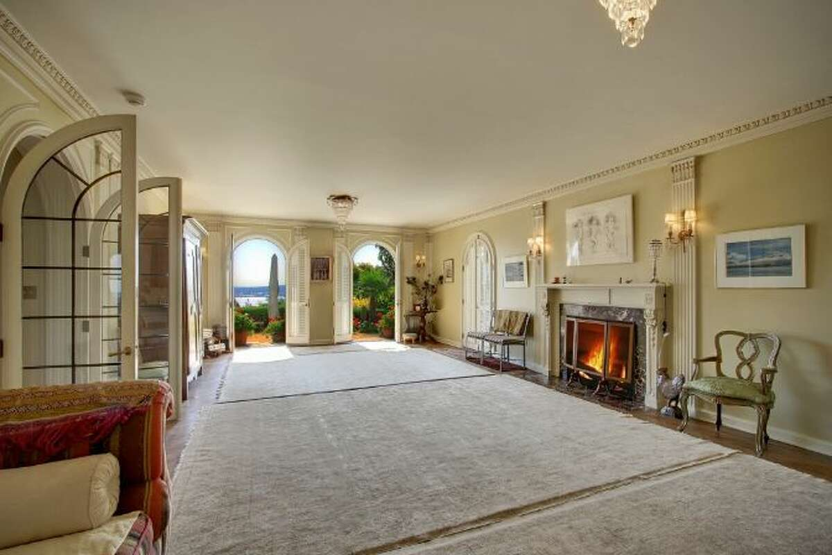Hall of 619 W. Comstock St., in Queen Anne, which is listed for sale for $6.8 million. The 10,600-square-foot mansion, built in 1926, has seven bedrooms, five bathrooms, a second kitchen, a wine cellar, arched doorways, French doors, high ceilings, massive moldings, a grand balcony, a koi pond and views of downtown Seattle, Mount Rainier, Elliott Bay and Puget Sound on a 0.42-acre lot. It's listed for $6.8 million.