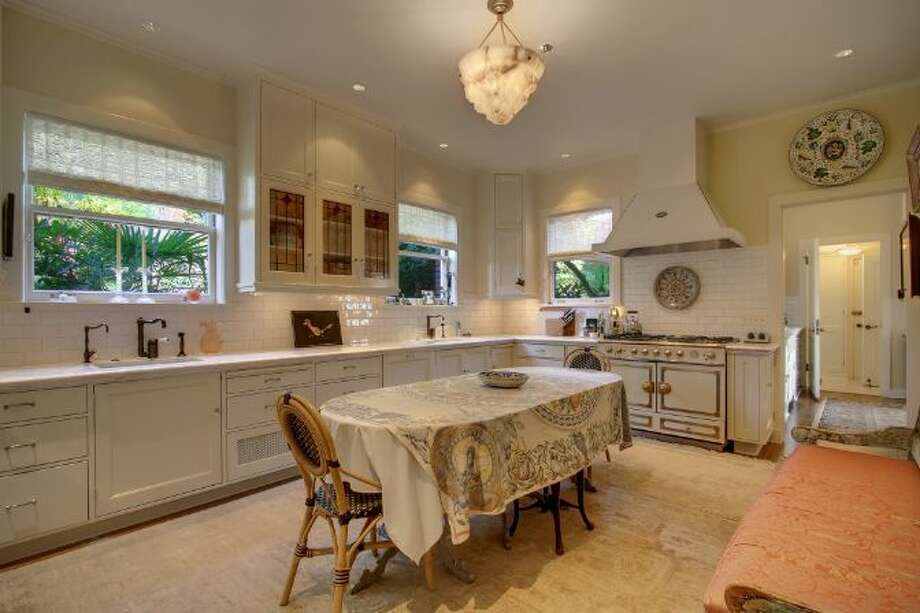 Kitchen of 619 W. Comstock St., in Queen Anne, which is listed for sale for $6.8 million. The 10,600-square-foot mansion, built in 1926, has seven bedrooms, five bathrooms, a second kitchen, a wine cellar, arched doorways, French doors, high ceilings, massive moldings, a grand balcony, a koi pond and views of downtown Seattle, Mount Rainier, Elliott Bay and Puget Sound on a 0.42-acre lot. It's listed for $6.8 million. Photo: Courtesy Ann Dover, Windermere Real Estate