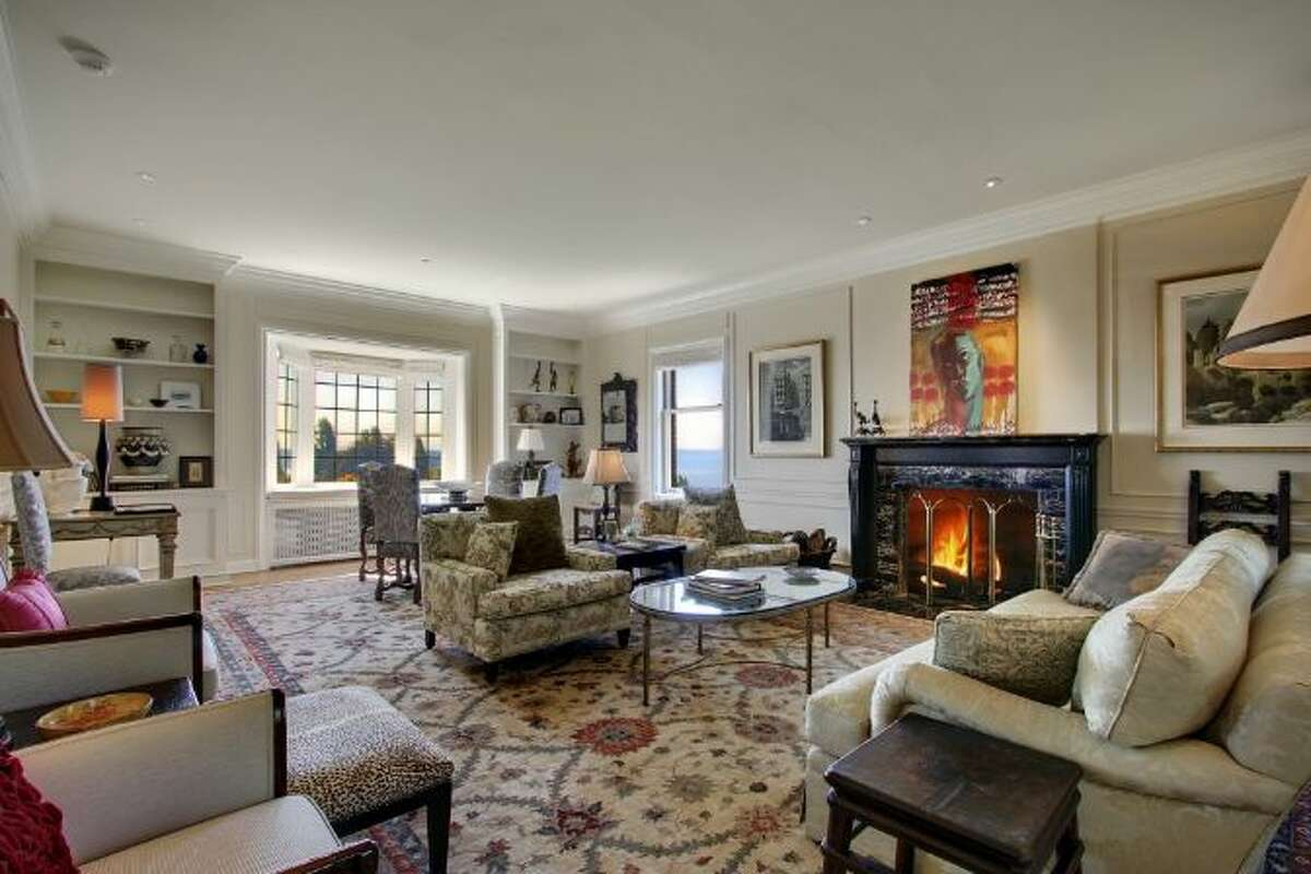 Living room of 619 W. Comstock St., in Queen Anne, which is listed for sale for $6.8 million. The 10,600-square-foot mansion, built in 1926, has seven bedrooms, five bathrooms, a second kitchen, a wine cellar, arched doorways, French doors, high ceilings, massive moldings, a grand balcony, a koi pond and views of downtown Seattle, Mount Rainier, Elliott Bay and Puget Sound on a 0.42-acre lot. It's listed for $6.8 million.