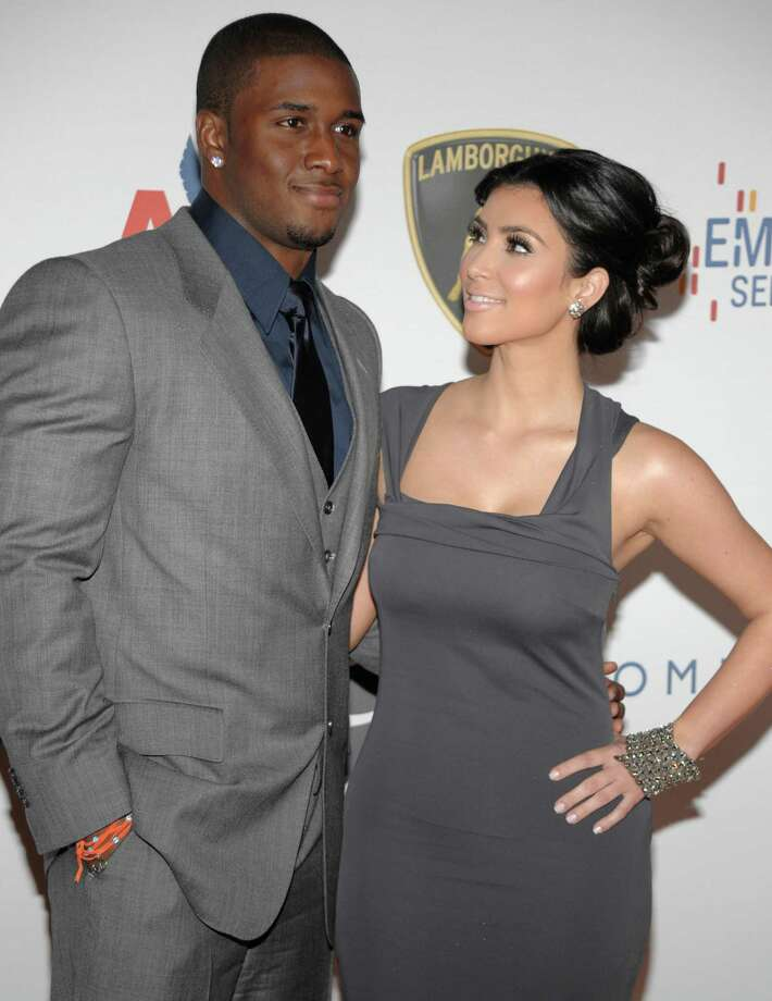 Kim has publicly gone through several relationships with various men, such as football star Reggie Bush. Photo: DAN STEINBERG, AP / R-STEINBERG