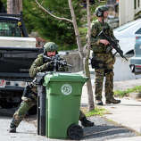 SWAT teams searched homes along Winsor Avenue in Watertown while searching for one of the two suspects in the terrorist bombing of the 117th Boston Marathon earlier this week.
