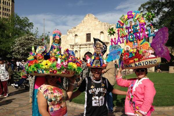 Dora Gonzales, Albert Limon and Pauline Grossman go bonkers with their Fiesta hats.