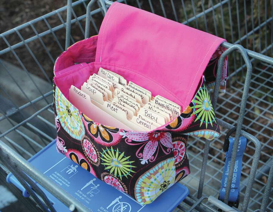 etsy.com Coupon purses , like this one, that fits over the shopping cart may help you get organized.