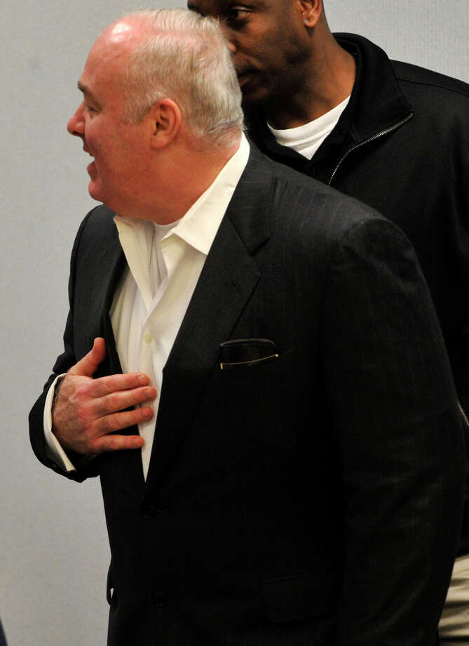 Michael Skakel greets friends and family as he enters the courtroom on the fourth day of his habeas corpus trial at State Superior Court in Vernon, Conn., on Friday, April 19, 2013. Photo: Jason Rearick / Stamford Advocate