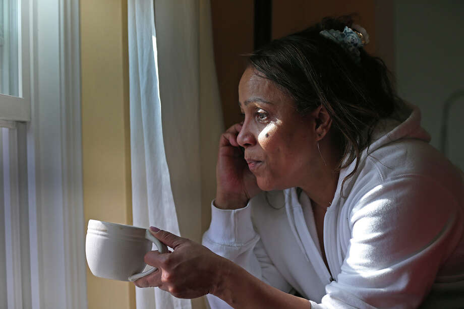 Katia Costa looks out her window at all the police activity below on the street at Nichols Avenue during the ongoing manhunt for a suspect in the terrorist bombing of the 117th Boston Marathon earlier this week. Watertown is on lockdown following a chase and shootout in the area last night. Photo: Boston Globe, Getty Images / 2013 - The Boston Globe