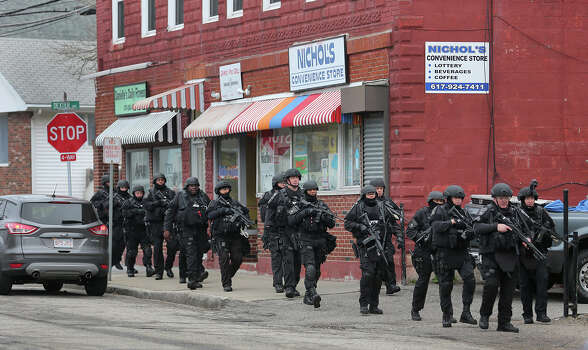 SWAT search on Nichols Avenue at the corner of Dexter during the ongoing manhunt for a suspect in the terrorist bombing of the 117th Boston Marathon earlier this week. Watertown is on lockdown following a chase and shootout in the area last night. Photo: Boston Globe, Getty Images / 2013 - The Boston Globe