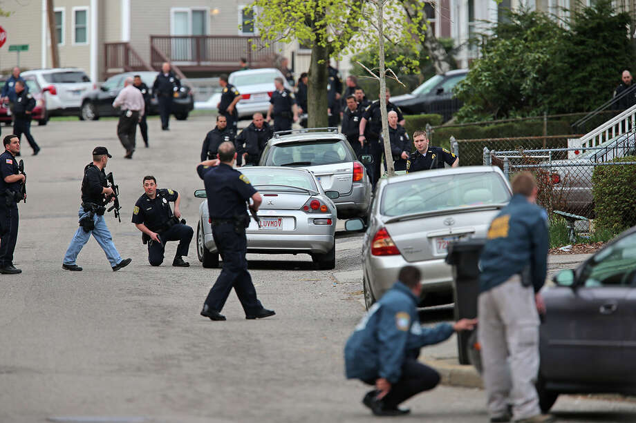 Police action at 17 Willow Avenue during the ongoing manhunt for a suspect in the terrorist bombing of the 117th Boston Marathon earlier this week. Watertown is on lockdown following a chase and shootout in the area last night. Photo: Boston Globe, Getty Images / 2013 - The Boston Globe