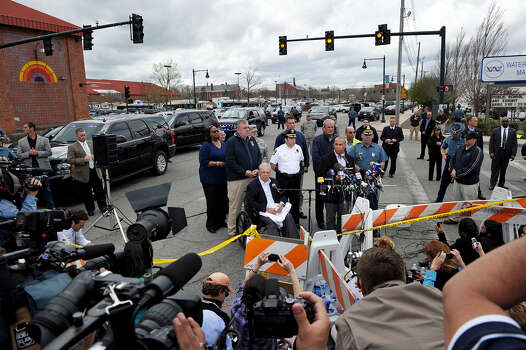 Massachusetts Governor Deval Patrick (at microphone) speaks to the media with Boston Mayor Thomas Menino (L, in wheelchair),  Boston Police Commissioner Ed Davis (L, behind Menino) and Watertown Chief of Police Edward P. Deveau (R, behind Patrick) at the Watertown Mall as a search for the second of two suspects wanted in the Boston Marathon bombings takes place April 19, 2013 in Watertown, Massachusetts. Photo: STAN HONDA, Getty Images / 2013 AFP