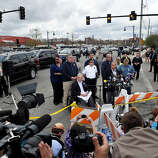 Massachusetts Governor Deval Patrick (at microphone) speaks to the media with Boston Mayor Thomas Menino (L, in wheelchair),  Boston Police Commissioner Ed Davis (L, behind Menino) and Watertown Chief of Police Edward P. Deveau (R, behind Patrick) at the Watertown Mall as a search for the second of two suspects wanted in the Boston Marathon bombings takes place April 19, 2013 in Watertown, Massachusetts.