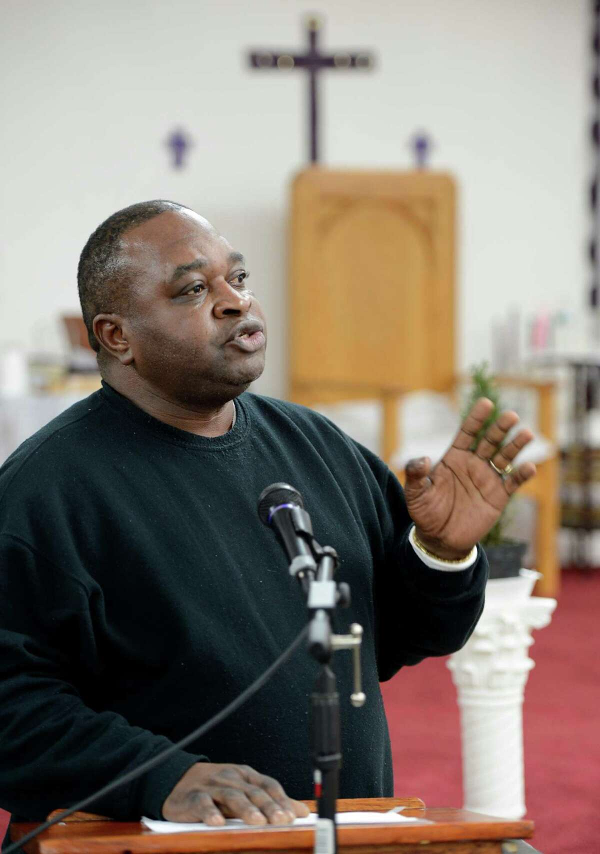 Pastor Willie D. Bacote leads the gathering in prayer on Martin Luther King Jr. Day Jan. 21, 2013 at the Missing Link Street AME Zion Church in Troy, N.Y. (Skip Dickstein/Times Union)