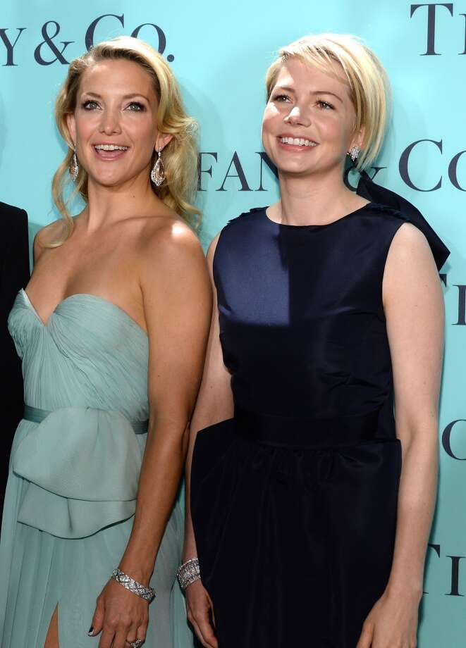 Actresses (L-R) Kate Hudson and Michelle Williams is wearing Diamonds from the Tiffany & Co. 2013 Blue Book Collection as she attends the Tiffany & Co. Blue Book Ball at Rockefeller Center on April 18, 2013 in New York City.