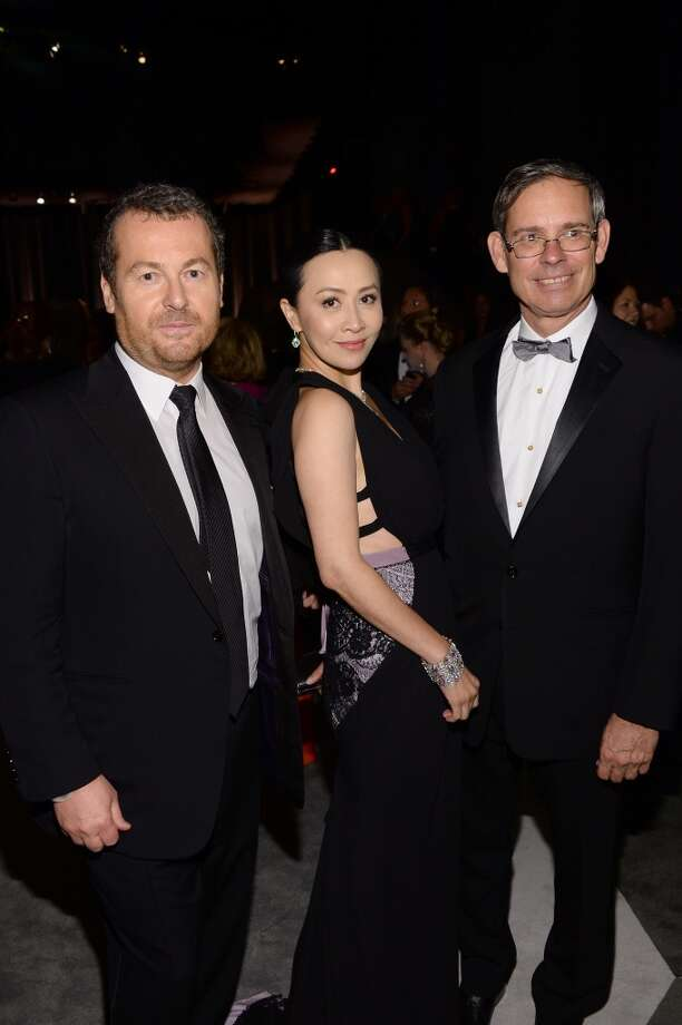 Frederic Cumenal, Executive Vice President of Tiffany & Co. and Chairman and CEO Mike Kowalski (R) pose with actress Carina Lau at the Tiffany & Co. Blue Book Ball at Rockefeller Center on April 18, 2013 in New York City.