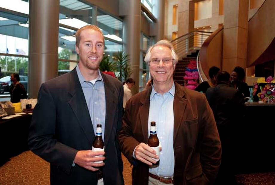 Ryan and Wayne Smith (left to right) at the GR8 event, at the Royal Sonesta Hotel, Houston, Texas on the 18th April 2013. Photo: Spike Johnson, For The Chronicle / Houston Chronicle