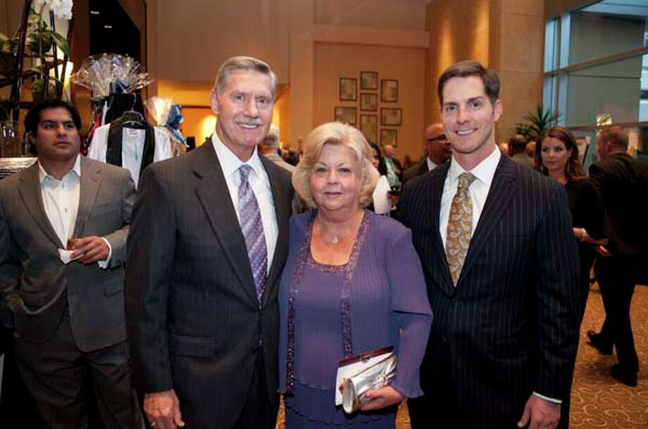 Bruce and Gale Flynn, Matt Schaub's parents-in-law, with their son Kevin at the GR8 event, at the Royal Sonesta Hotel, Houston, Texas on the 18th April 2013. Photo: Spike Johnson, For The Chronicle / Houston Chronicle