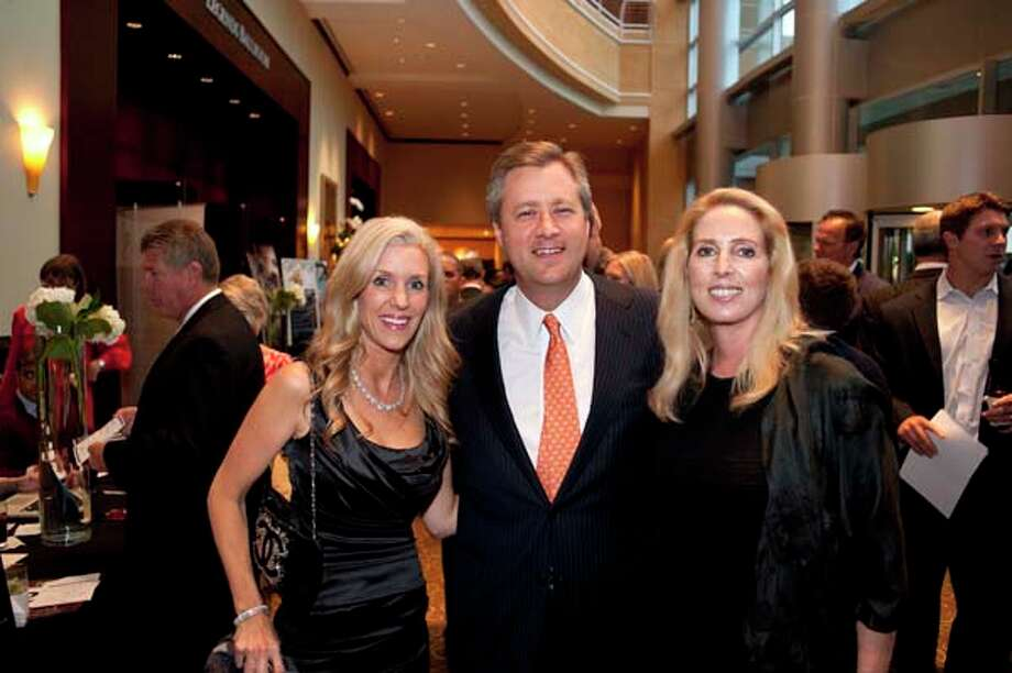 Michelle Smith with Andrew and Shannon Linbeck (left to right) at the GR8 event, at the Royal Sonesta Hotel, Houston, Texas on the 18th April 2013. Photo: Spike Johnson, For The Chronicle / Houston Chronicle