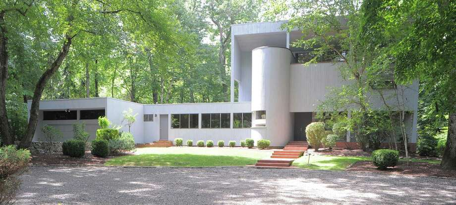 This Contemporary house at 6 Viking Green is nestled among elements of nature, including tall trees and the Saugatuck River. Photo: Contributed Photo