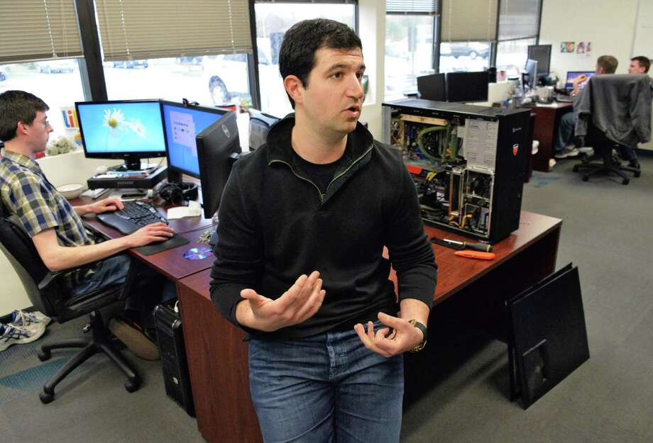 Abraham Sultan, center, co-founder of Apprenda, discusses his software company's start up at their offices in Clifton Park, N.Y., Tuesday April 16, 2013.  (John Carl D'Annibale / Times Union) Photo: John Carl D'Annibale / 10021961A