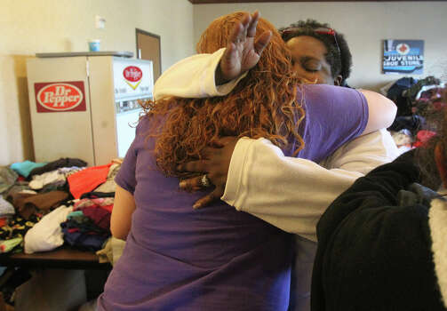 Vivian Green (facing)) hugs Jami Staggs after praying Friday April 19, 2013 at the Best Western Hotel in West, Texas. The hotel has become an area for residents affected by the fertilizer plant explosion to seek refuge, obtain food and nourishment and clothing. Green's home was damaged by the explosion and is stying with a friend. Photo: JOHN DAVENPORT, SAN ANTONIO EXPRESS-NEWS / SAN ANTONIO EXPRESS-NEWS