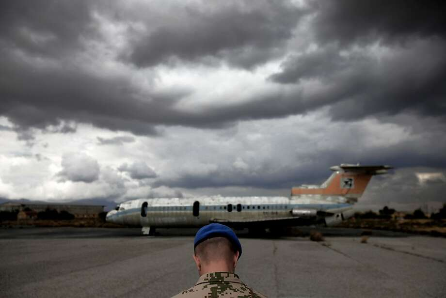 A dilapidated Cyprus Airways plane sits on the tarmac at abandoned Nicosia airport in the divided capital. The grounds of the old airport now serve as the headquarters for the United Nations peacekeeping force. Photo: Petros Karadjias, Associated Press
