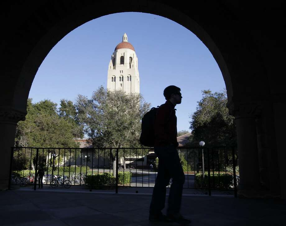 FILE - In this Feb. 15, 2012 file photo, a Stanford University student walks in front of Hoover Tower on the Stanford University campus in Palo Alto, Calif. Congressional inaction could end up costing college students an extra $5,000 on their new loans. The rate for subsidized Stafford loans is set to increase from 3.4 percent to 6.8 percent on July 1, just as millions of new college students start signing up for fall courses. The difference between the two rates adds up to $6 billion. (AP Photo/Paul Sakuma, File) Photo: Paul Sakuma, Associated Press