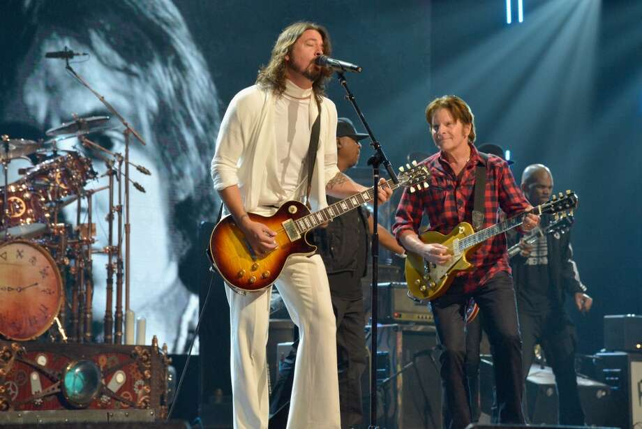 Musicians Dave Grohl and John Fogerty perform onstage during the 28th Annual Rock and Roll Hall of Fame Induction Ceremony at Nokia Theatre L.A. Live on April 18, 2013 in Los Angeles, California.  (Photo by Lester Cohen/WireImage)