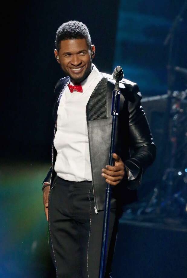 Singer Usher performs onstage during the 28th Annual Rock and Roll Hall of Fame Induction Ceremony at Nokia Theatre L.A. Live on April 18, 2013 in Los Angeles, California.  (Photo by Kevin Kane/WireImage)