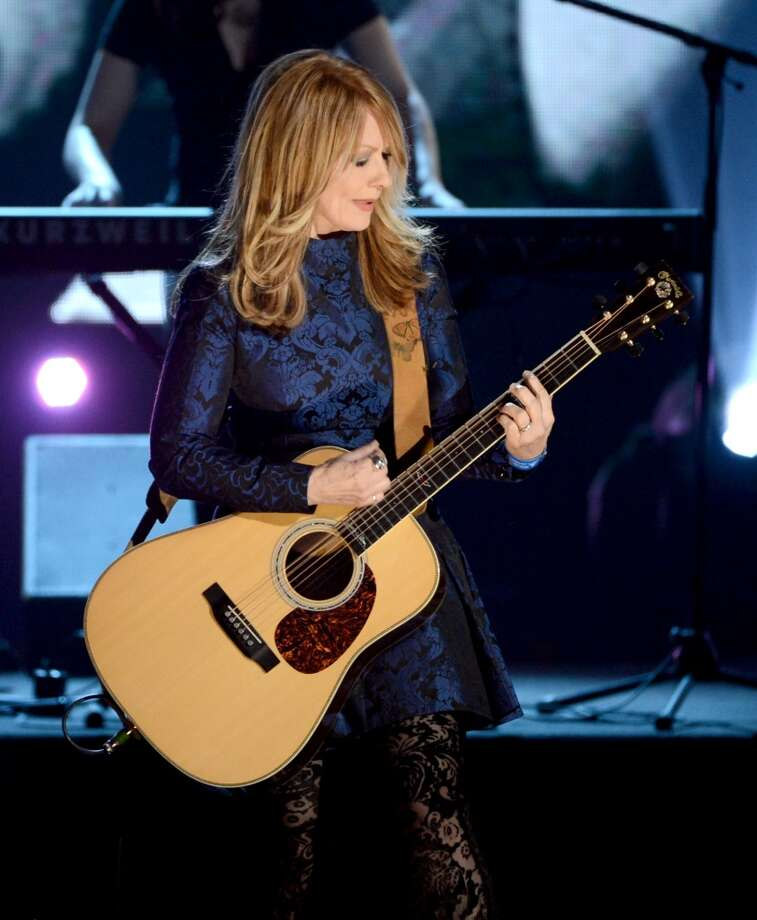 Inductee Nancy Wilson of Heart performs on stage at the 28th Annual Rock and Roll Hall of Fame Induction Ceremony at Nokia Theatre L.A. Live on April 18, 2013 in Los Angeles, California.  (Photo by Kevin Winter/Getty Images)