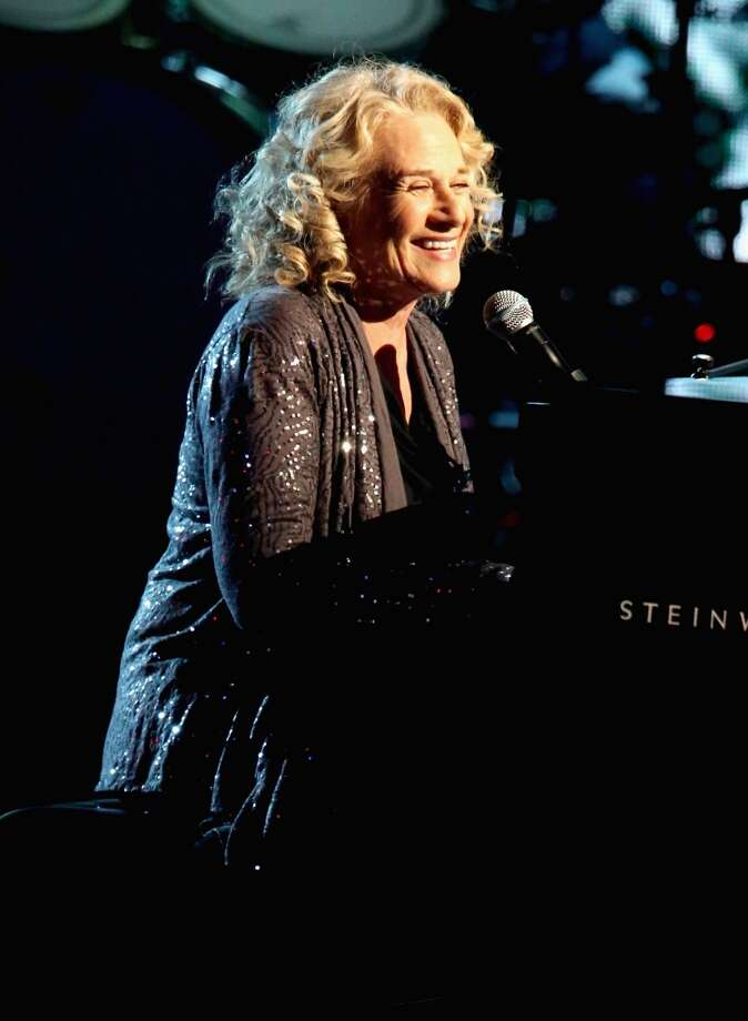 Musician Carole King performs onstage during the 28th Annual Rock and Roll Hall of Fame Induction Ceremony at Nokia Theatre L.A. Live on April 18, 2013 in Los Angeles, California.  (Photo by Kevin Kane/WireImage)