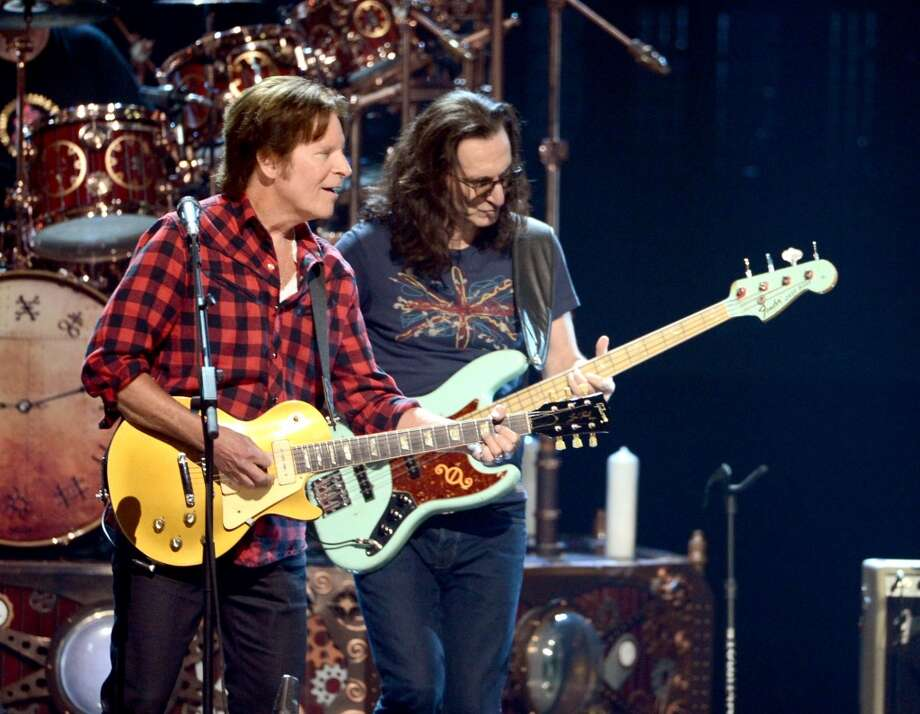Musician John Fogerty (L) and  Inductee Geddy Lee perform onstage at the 28th Annual Rock and Roll Hall of Fame Induction Ceremony at Nokia Theatre L.A. Live on April 18, 2013 in Los Angeles, California.  (Photo by Kevin Winter/Getty Images)