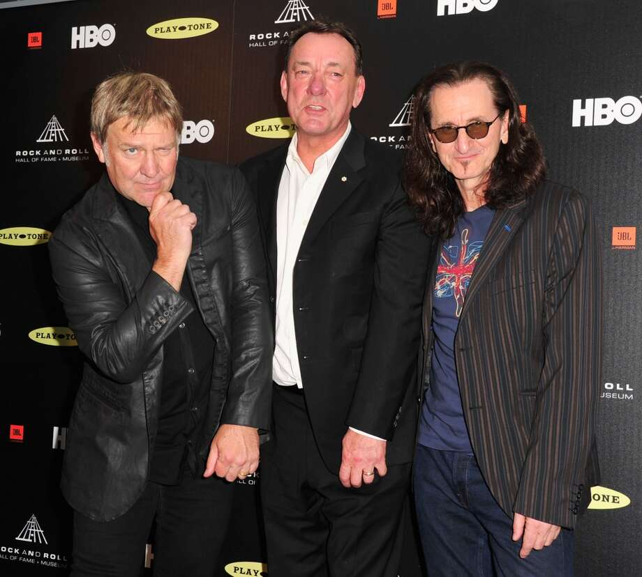 (L-R) Inductees Alex Lifeson, Neil Peart and Geddy Lee of Rush pose in the press room at the 28th Annual Rock and Roll Hall of Fame Induction Ceremony at Nokia Theatre L.A. Live at Nokia Theatre L.A. Live on April 18, 2013 in Los Angeles, California.  (Photo by Mark Sullivan/FilmMagic)