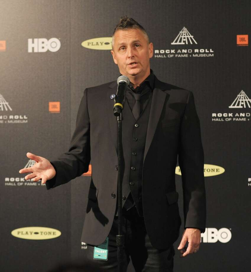Musician Mike McCready of Pearl Jam poses in the press room at the 28th Annual Rock and Roll Hall of Fame Induction Ceremony at Nokia Theatre L.A. Live at Nokia Theatre L.A. Live on April 18, 2013 in Los Angeles, California.