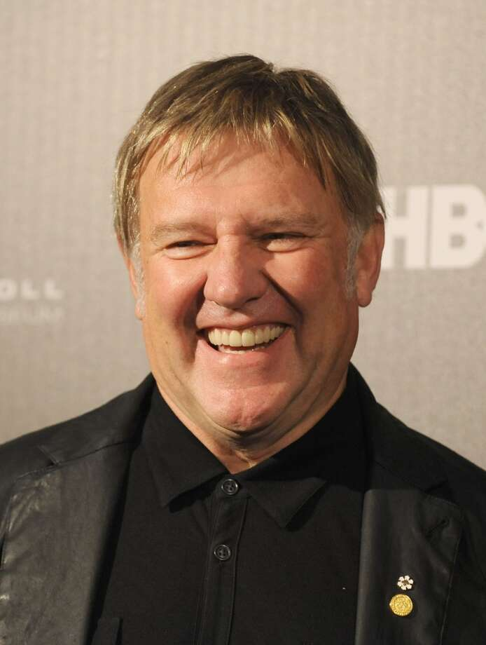Inductee Alex Lifeson poses in the press room at the 28th Annual Rock and Roll Hall of Fame Induction Ceremony at Nokia Theatre L.A. Live at Nokia Theatre L.A. Live on April 18, 2013 in Los Angeles, California.