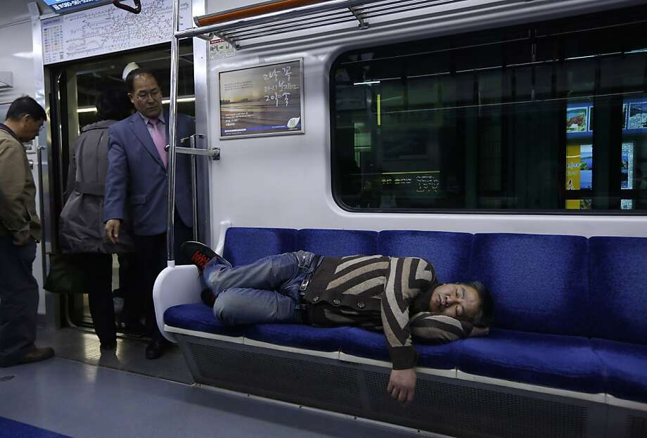 Sleep train: A subway rider slumbers through a stop in Seoul. Photo: Kin Cheung, Associated Press