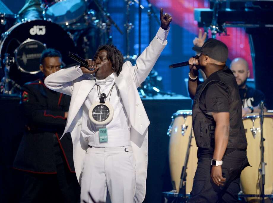 (L-R) Indcutees Professor Griff, Flavor Flav, Chuck D, and Termintor X perform on stage at the 28th Annual Rock and Roll Hall of Fame Induction Ceremony at Nokia Theatre L.A. Live on April 18, 2013 in Los Angeles, California.  (Photo by Kevin Winter/Getty Images)