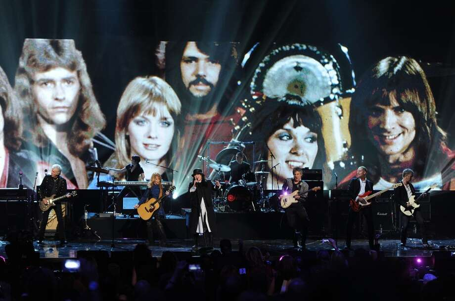 (L-R) Inductees Howard Leese, Nancy Wilson, Ann Wilson, Steve Fossen and Jerry Cantrell of Heart perform on stage at the 28th Annual Rock and Roll Hall of Fame Induction Ceremony at Nokia Theatre L.A. Live on April 18, 2013 in Los Angeles, California.  (Photo by Kevin Winter/Getty Images)