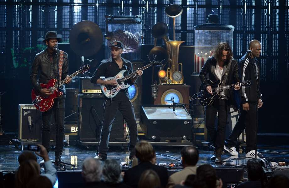 L-R) Musicians Gary Clark Jr., Tom Morello and Chris Cornell perform onstage at the 28th Annual Rock and Roll Hall of Fame Induction Ceremony at Nokia Theatre L.A. Live on April 18, 2013 in Los Angeles, California.  (Photo by Kevin Winter/Getty Images)