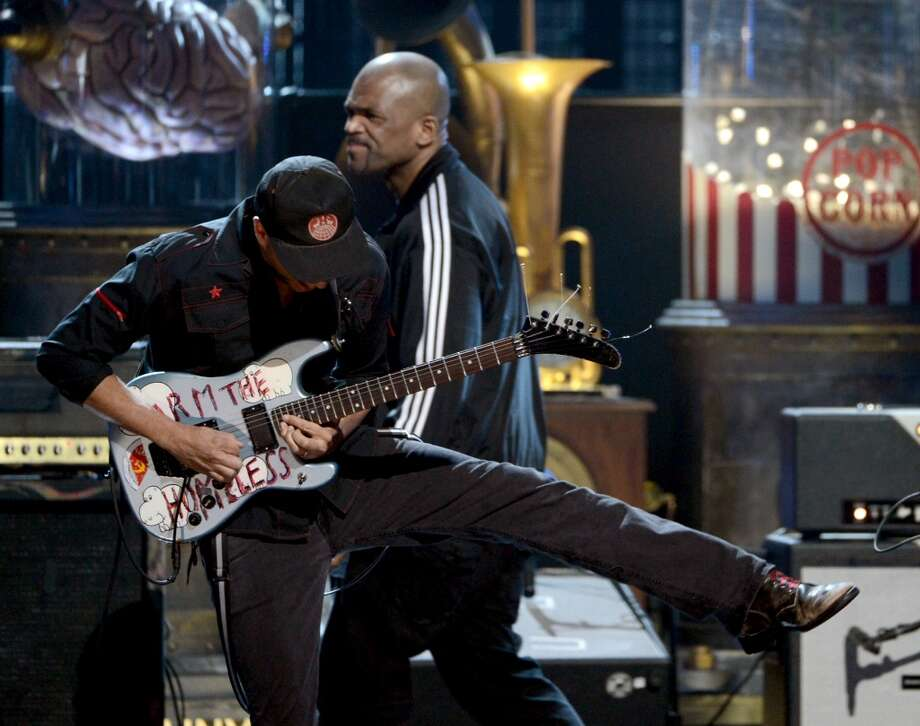 "Musicians Tom Morello and Darryl ""D.M.C.\"" McDaniels perform onstage at the 28th Annual Rock and Roll Hall of Fame Induction Ceremony at Nokia Theatre L.A. Live on April 18, 2013 in Los Angeles, California.  (Photo by Kevin Winter/Getty Images)"