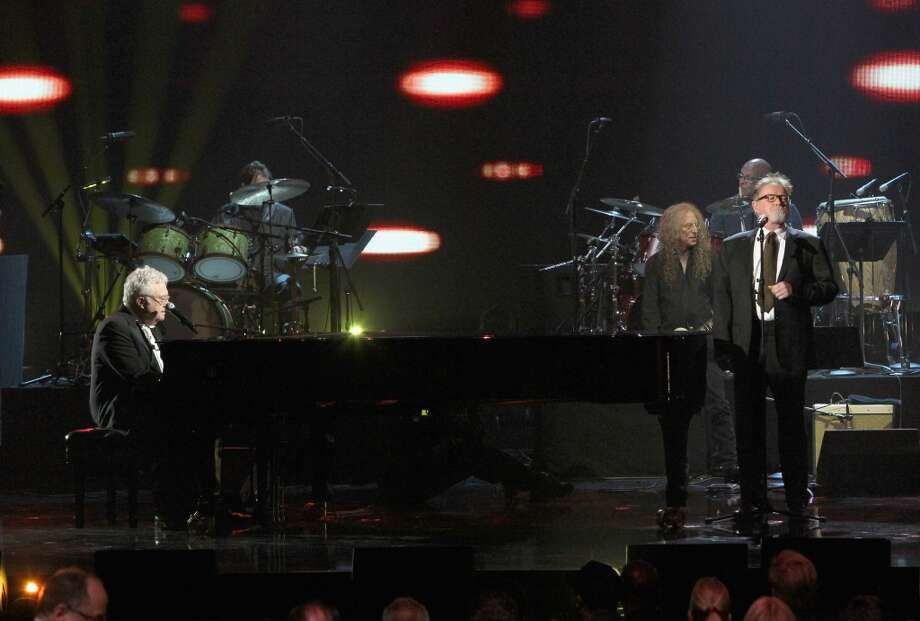 Inductee Randy Newman (L) and musician Don Henley (R) perform onstage during the 28th Annual Rock and Roll Hall of Fame Induction Ceremony at Nokia Theatre L.A. Live on April 18, 2013 in Los Angeles, California.  (Photo by Kevin Kane/WireImage)