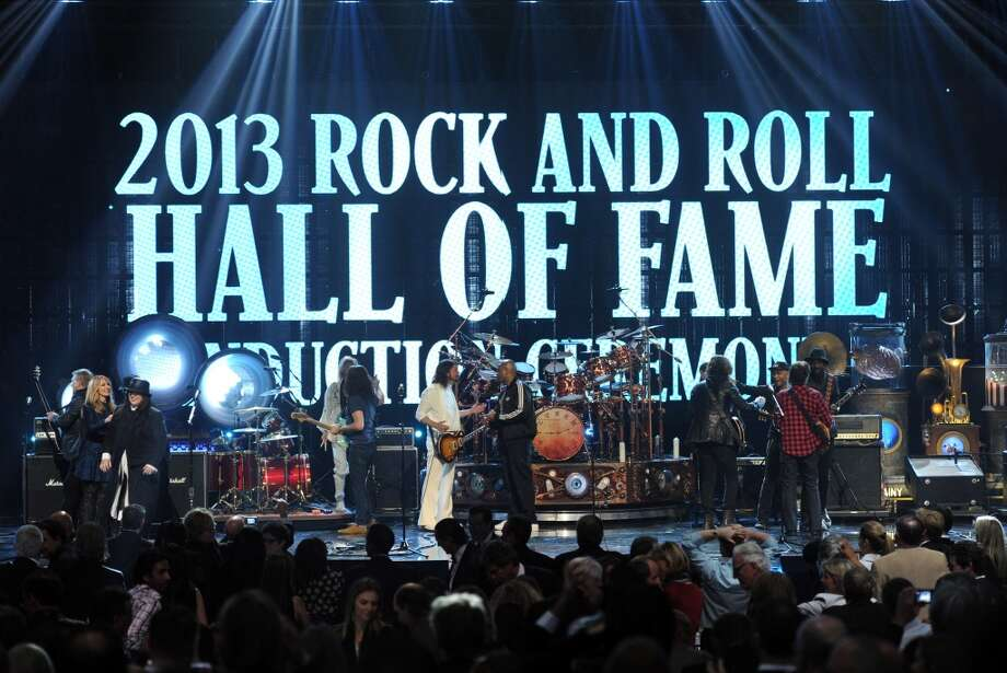 """(L-R) Inductees Ann Wilson and Nancy Wilson of Heart and Alex Lifeson of Rush, musicians Taylor Hawkins and Dave Grohl of Foo Fighters, inductees Neil Peart and Geddy Lee of Rush, MC Darryl \""""D.M.C.\"""" McDaniels, inductee Chuck D of Public Enemy and musicians Gary Clark Jr., John Fogerty, Tom Morello and Chris Cornell perform onstage at the 28th Annual Rock and Roll Hall of Fame Induction Ceremony at Nokia Theatre L.A. Live on April 18, 2013 in Los Angeles, California.  (Photo by Kevin Winter/Getty Images)"""