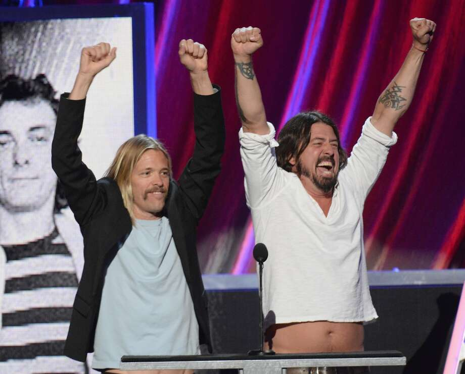 Musicians Dave Grohl (R) and Taylor Hawkins onstage at the 28th Annual Rock and Roll Hall of Fame Induction Ceremony at Nokia Theatre L.A. Live on April 18, 2013 in Los Angeles, California.  (Photo by Jeff Kravitz/FilmMagic)