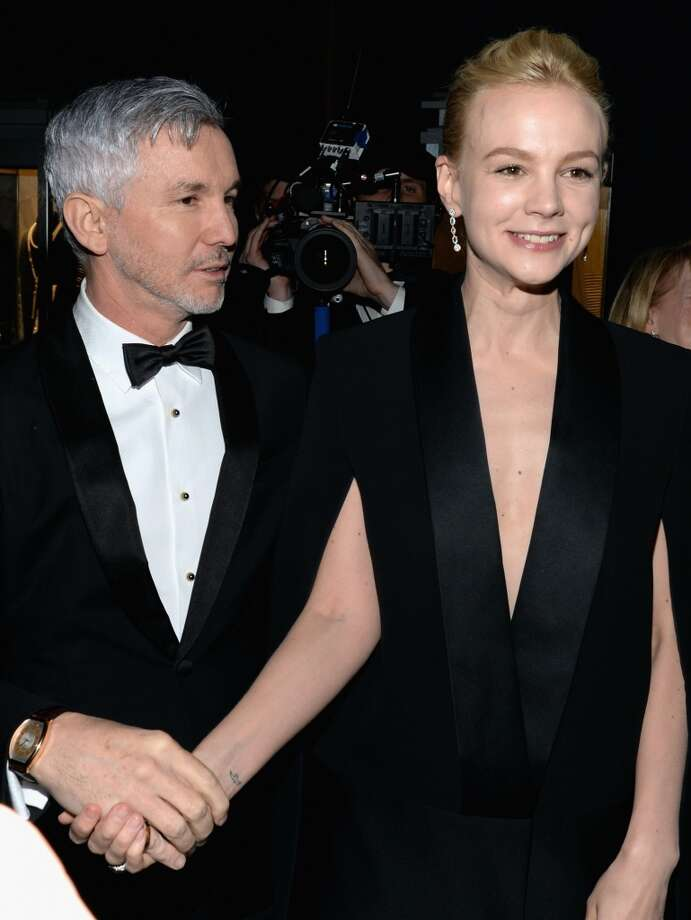 Baz Luhrmann, director/producer/co-writer of \'The Great Gatsby\' and Carey Mulligan attends the Tiffany & Co. Blue Book Ball at Rockefeller Center on April 18, 2013 in New York City.