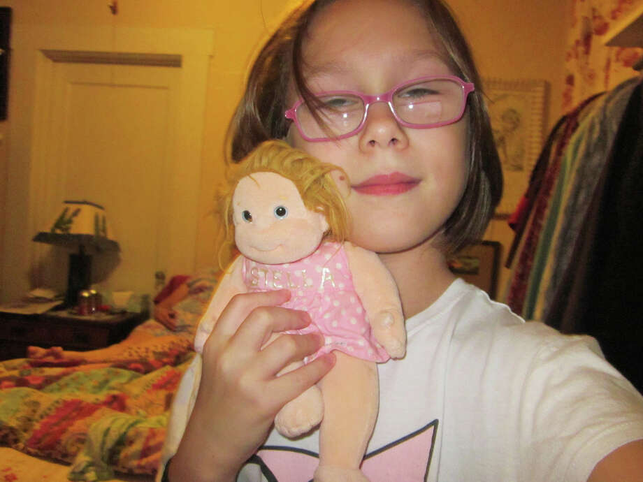 """""""2 Stellas"""" by Stella Carrillo-Brown, a student at Love Elementary School (and little sister of Dylan Carrillo-Brown, another student photographer in the Pozos Art Project). """"When I was little, my mom got me this doll, and I named her Stella too."""" Photo: Stella Carrillo-Brown / Pozos Art Project"""