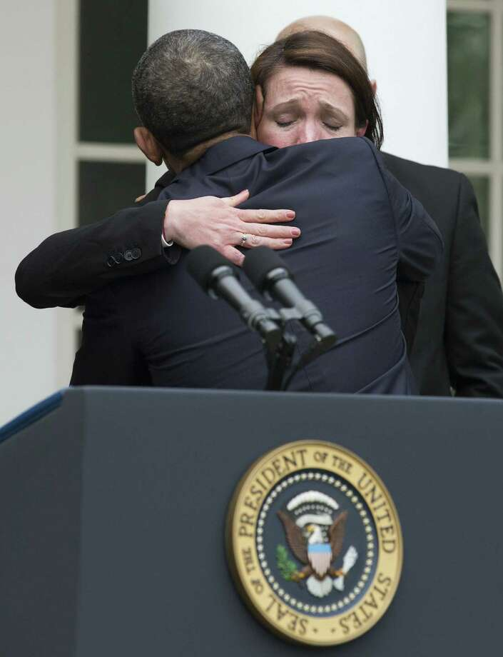 President Barack Obama hugs Nicole Hockley, who lost her son, Dylan, at Sandy Hook Elementary School,  after the Senate vote. Readers weigh in on both sides of the issue. Photo: Maurice Balce Ceneta, Associated Press