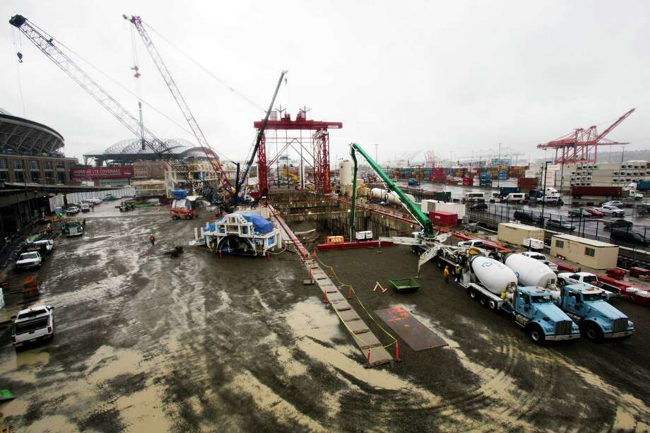 WSDOT officials lead a guided tour of the Alaskan Way Viaduct replacement program's progress at the site of the Bertha SR 99 tunneling machine and launch point Friday west of CenturyLink Field in Seattle. The 41 pieces that make up the drill have been unloaded from the cargo ship Jumbo Fairpartner and are now stored around the site. Later this month, crews will begin lowering the pieces into the launch pit for reassembly and testing. Photo: JORDAN STEAD, SEATTLEPI.COM / SEATTLEPI.COM